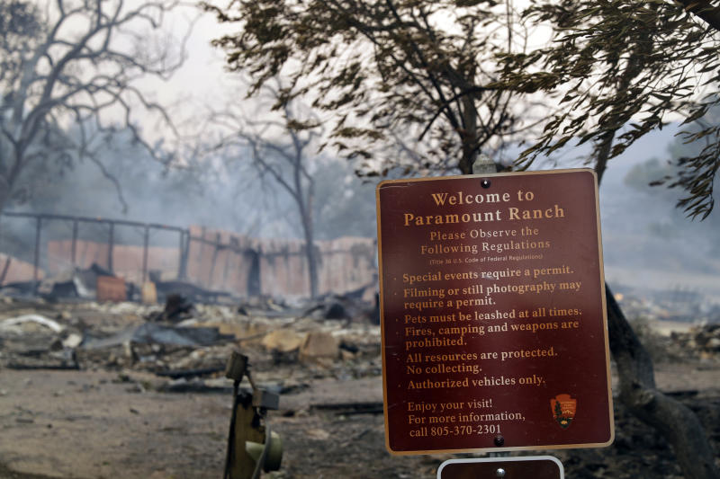 This Friday, Nov. 9, 2018 file photo shows Paramount Ranch, a frontier western town built as a movie set that appeared in countless movies and TV shows, after it was decimated by the Woolsey fire in Agoura Hills, Calif. Southern Californians faced with the loss of lives and homes in a huge wildfire are also grappling with the destruction of public lands popular with hikers, horseback riders and mountain bikers. The Woolsey fire has charred more than 83 percent of National Park Service land within the Santa Monica Mountain National Recreational Area. (AP Photo/Marcio Jose Sanchez)