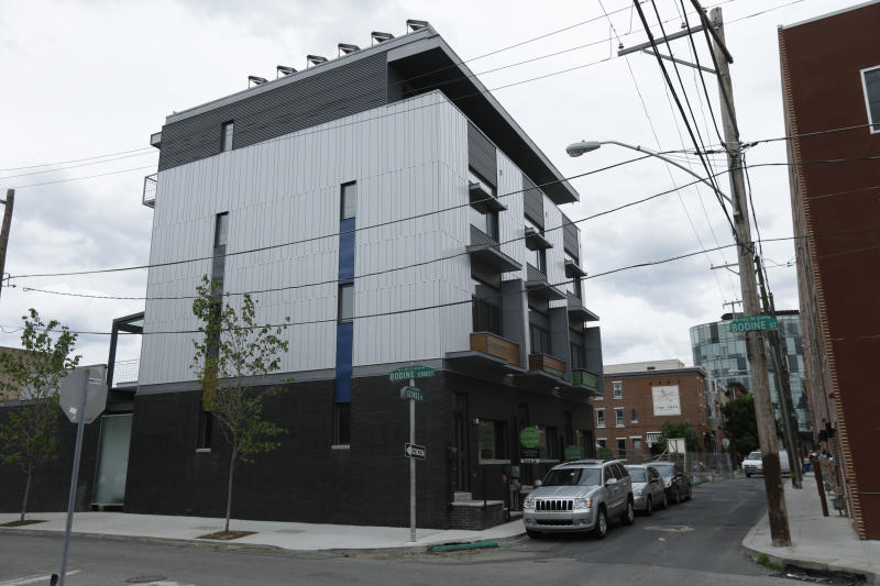 This June 6, 2013 photo shows passive homes in The Stables development in Philadelphia. These homes are built around the idea that houses can be airtight, super-insulated and energy efficient. The goal: a house that creates nearly as much energy as it consumes. (AP Photo/Matt Rourke)