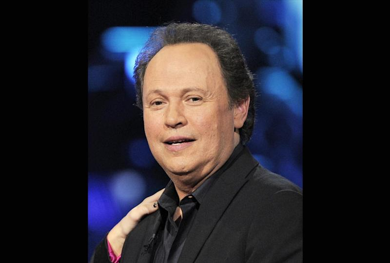 """FILE - In this April 6, 2008 file photo, Billy Crystal is shown at the """"Idol Gives Back"""" fundraising special of """"American Idol"""" in Los Angeles. Actor Billy Crystal has helped raise $1 million to rebuild a beach town on New York's Long Island hard-hit by Superstorm Sandy, Saturday, June 22, 2013. (AP Photo/Mark J. Terrill, File)"""