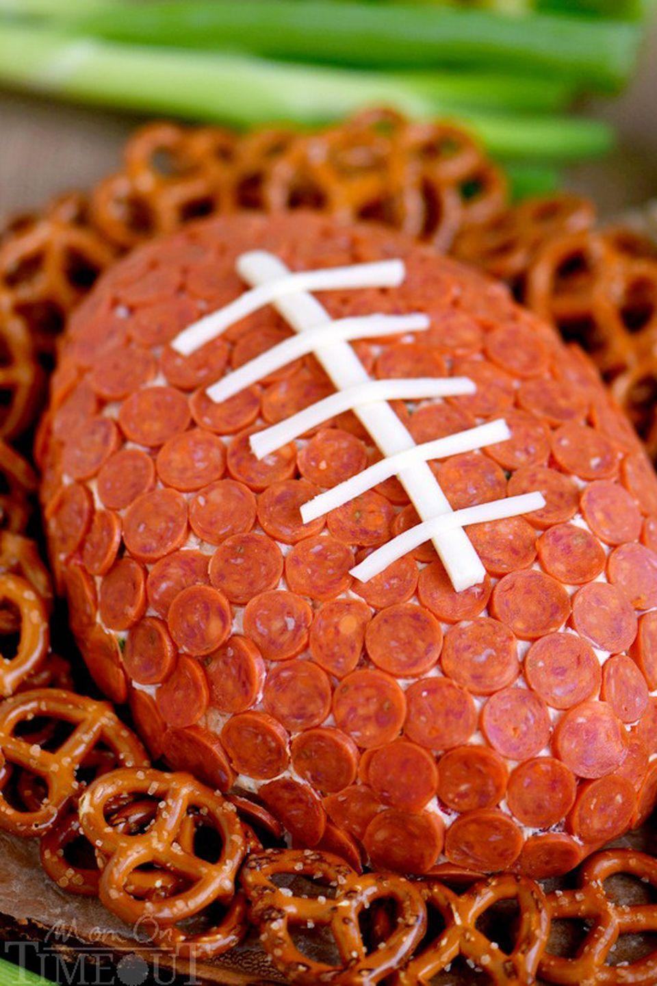 "<p>One look at this football-shaped cheese ball covered in pepperoni, and your guests will be awarding you the MVP award.</p><p><strong>Get the recipe from <a href=""http://www.momontimeout.com/2015/10/pepperoni-pizza-football-cheese-ball-recipe/"" rel=""nofollow noopener"" target=""_blank"" data-ylk=""slk:Mom on Time Out"" class=""link rapid-noclick-resp"">Mom on Time Out</a>.</strong> </p>"