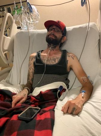 Jeffrey Manzanares lies in the intensive care unit of the University of Utah Hospital