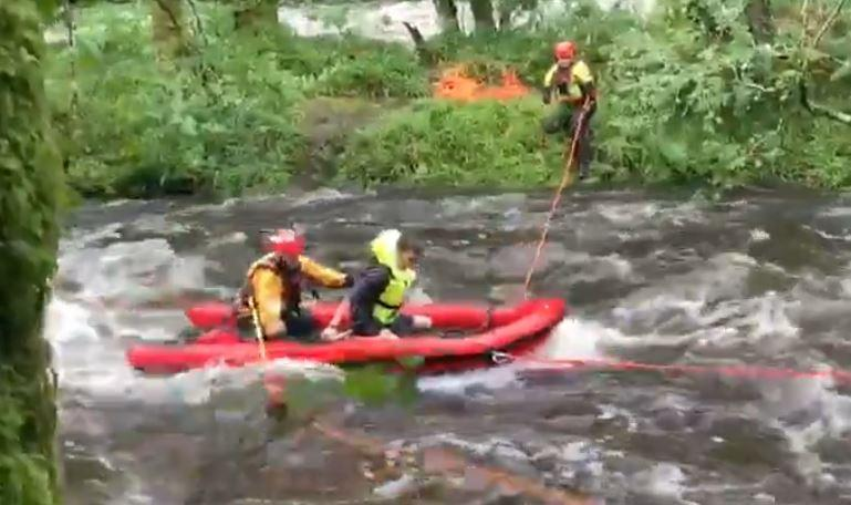 In total 30 rescuers helped retrieve the stranded friends using a boat (Picture: Devon & Somerset Fire & Rescue Service)