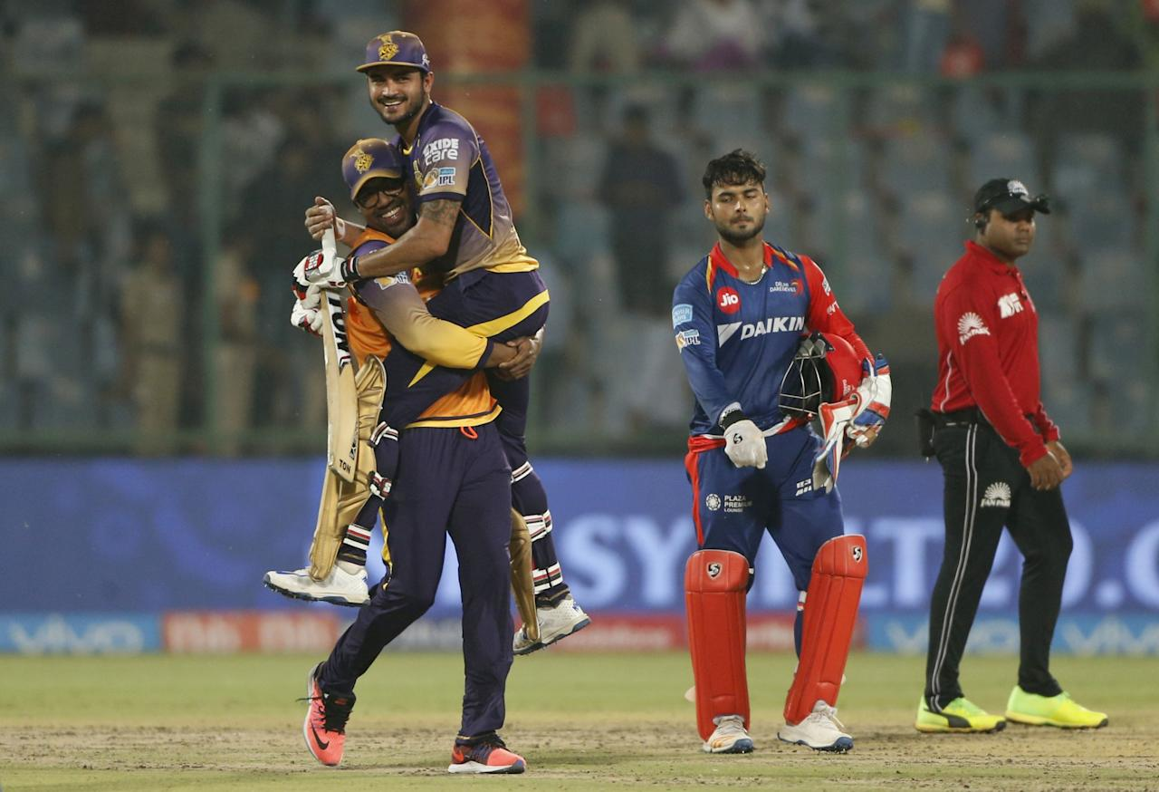 <p>Kolkata Knight Riders' Manish Pandey is lifted by his teammate as they celebrate after winning against Delhi Daredevils during their Indian Premier League cricket match in New Delhi, India. (AP Photo/Tsering Topgyal) </p>