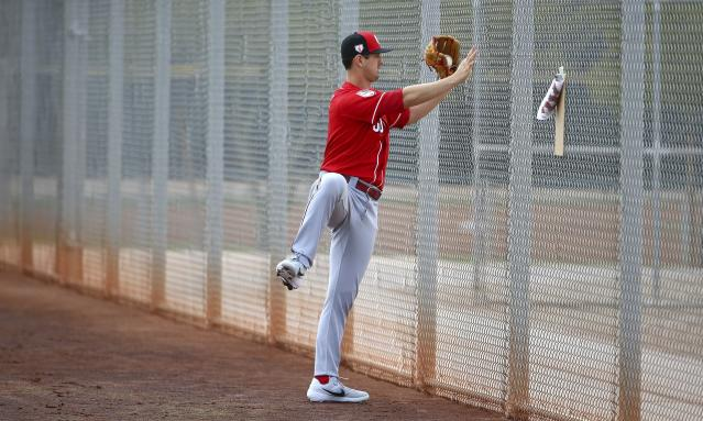 Cincinnati Reds pitcher Tyler Mahle does some extra stretching during a workout at the Reds spring training baseball facility, Wednesday, Feb. 13, 2019, in Goodyear, Ariz. (AP Photo/Ross D. Franklin)