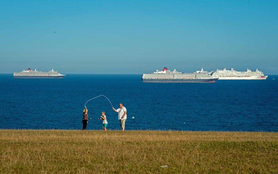 England's south coast has been home to many cruise ships while they're without passengers - FINNBARR WEBSTER/GETTY