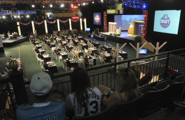 FILE - In this June 5, 2008, file photo, fans watch as Baseball Commissioner Bud Selig announces the second selection of the Minnesota Twins during the baseball draft in Lake Buena Vista, Fla. The Twins selected right-handed pitcher Carlos Gutierrez, from the University of Miami, with the pick. Baseballs amateur draft this week will look much different because of the coronavirus pandemic, and more permanent changes could be coming soon. (AP Photo/Phelan M. Ebenhack, File)