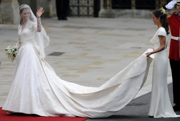 Kate Middleton waves as she arrives at the West Door of Westminster Abbey in London for her wedding to Prince William, on April 29, 2011.