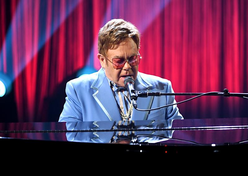 "BURBANK, CALIFORNIA - OCTOBER 16: Elton John performs live on stage at iHeartRadio ICONS with Elton John: Celebrating The Launch Of Elton John's Autobiography, ""Me"" at the iHeartRadio Theater Los Angeles on October 16, 2019. (Photo by Kevin Winter/Getty Images for iHeartMedia)"