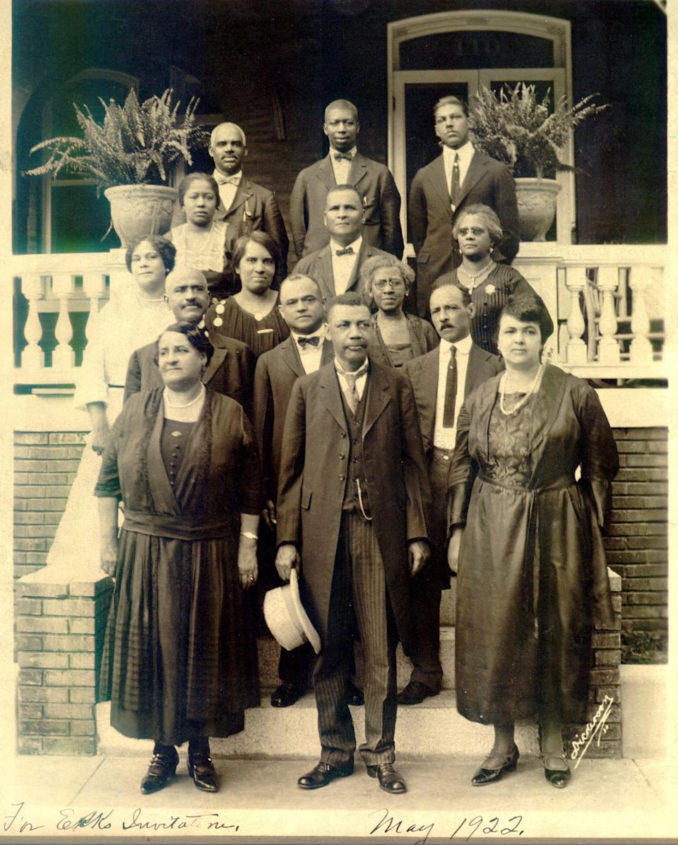 Maggie L. Walker, bottom left, and others in front of Walker's Jackson Ward home, May 1922.