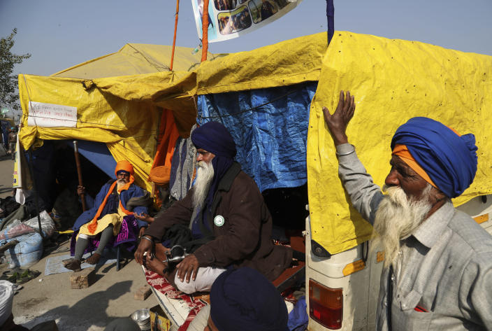 Sikh farmer sit at their make shift tents at Singhu, Delhi-Haryana border, camp for protesting farmers against three farm bills, in New Delhi, India, Wednesday, Jan. 27, 2021. Tens of thousands of farmers who stormed the historic Red Fort on India's Republic Day are again camped outside the capital after the most volatile day of their two-month standoff left one protester dead and more than 300 police officers injured. (AP Photo/Manish Swarup)