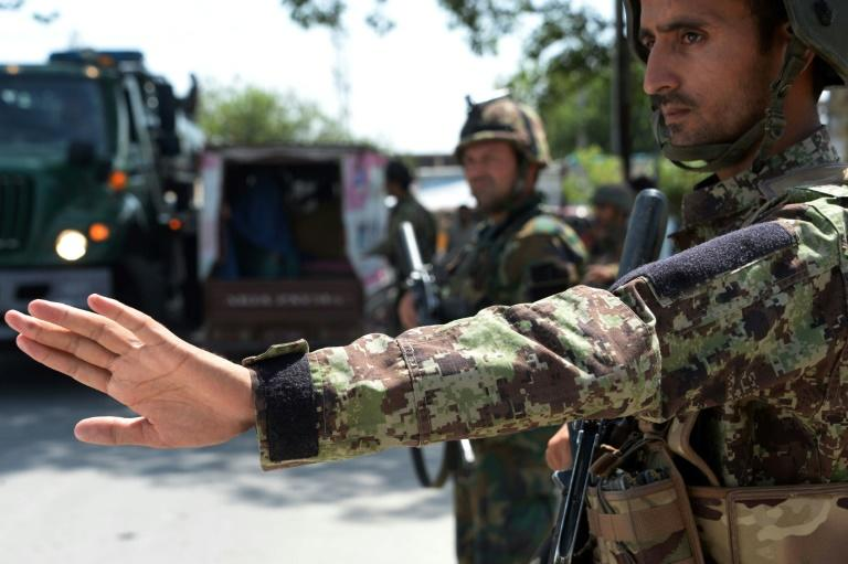 This 2018 file photo shows Afghan National Army (ANA) soldiers searching vehicles at a checkpoint in the city of Jalalabad