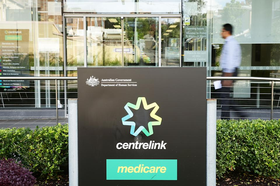 SYDNEY, AUSTRALIA - MARCH 21:  A man walks into a Medicare and Centrelink office at Bondi Junction on March 21, 2016 in Sydney, Australia. Federal public sector workers are expected to strike around Australia over a long-running pay dispute.  (Photo by Matt King/Getty Images)