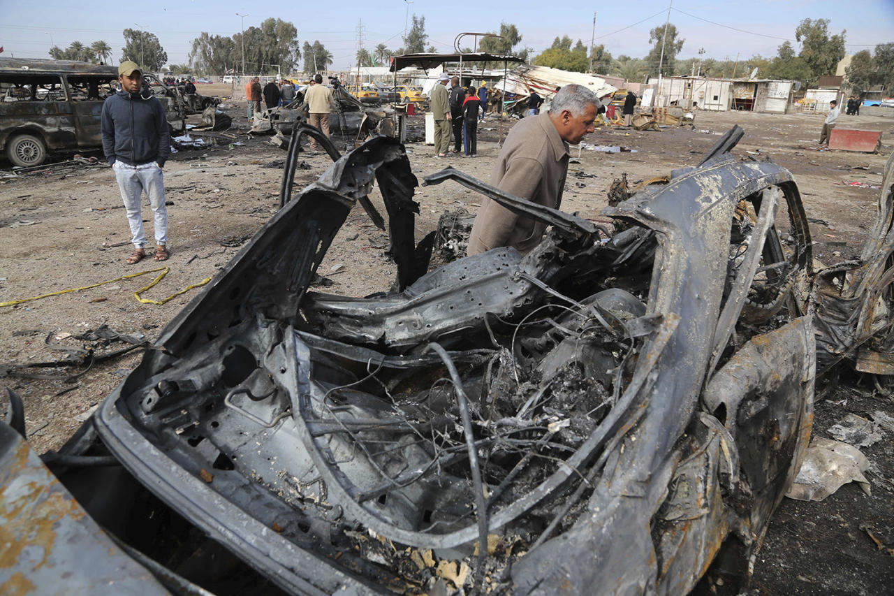 <p>Civilians inspect the aftermath of a car bomb attack in an auto dealership in the southwestern al-Bayaa neighborhood, Baghdad, Iraq, Friday, Feb. 17, 2017. The death toll from a car bomb attack in a southern Baghdad neighborhood has reached 59 with 66 others injured, a police officer and medical sources say. (AP Photo/ Karim Karim) </p>