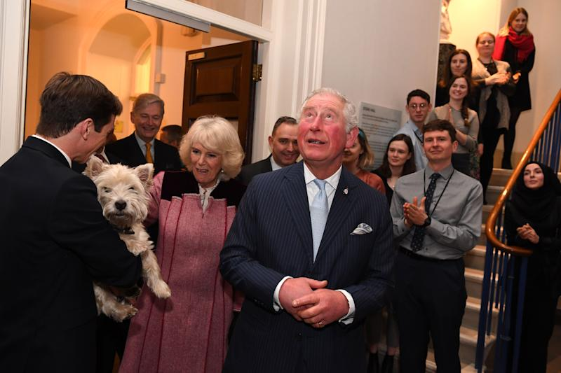 Britain's Prince Charles, Prince of Wales and Britain's Camilla, Duchess of Cornwall meet Monty the dog during a tour of the Cabinet Office in central London on February 13, 2020. - Their Royal Highnesses toured the Cabinet Office building to recognise the work it undertakes on behalf of the government. The Cabinet Office supports the Prime Minister and ensure the effective running of government. It is also the corporate headquarters for government, in partnership with HM Treasury, and takes the lead in certain critical policy areas. (Photo by DANIEL LEAL-OLIVAS / various sources / AFP) (Photo by DANIEL LEAL-OLIVAS/AFP via Getty Images)
