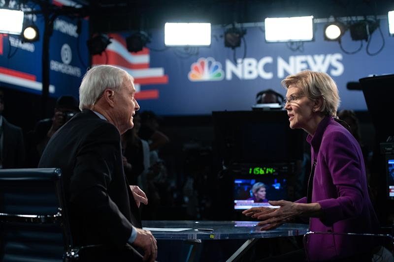 Democratic presidential hopeful US Senator from Massachusetts Elizabeth Warren with NBC anchor Chris Matthews in the Spin Room after participating in the first Democratic primary debate of the 2020 presidential campaign season hosted by NBC News at the Adrienne Arsht Center for the Performing Arts in Miami, Florida, June 26, 2019. (Photo by SAUL LOEB / AFP) (Photo credit should read SAUL LOEB/AFP/Getty Images)