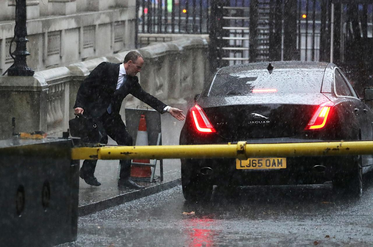 Britain's Secretary of State for Exiting the EU Dominic Raab reaches for the door of his car during heavy rain in Downing Street, London, Britain, November 12, 2018. REUTERS/Simon Dawson TPX IMAGES OF THE DAY