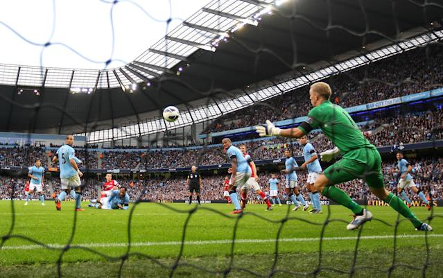 MANCHESTER, ENGLAND - SEPTEMBER 23: Joe Hart of Manchester City fails to save Laurent Koscielny of Arsenal's goal during the Barclays Premier League match between Manchester City and Arsenal at Etihad Stadium on September 23, 2012 in Manchester, England. (Photo by Alex Livesey/Getty Images)