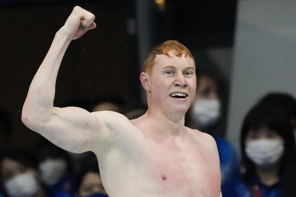 Tom Dean, of Britain, celebrates after winning the final of the men's 200-meter freestyle at the 2020 Summer Olympics, Tuesday, July 27, 2021, in Tokyo, Japan. (AP Photo/Petr David Josek)
