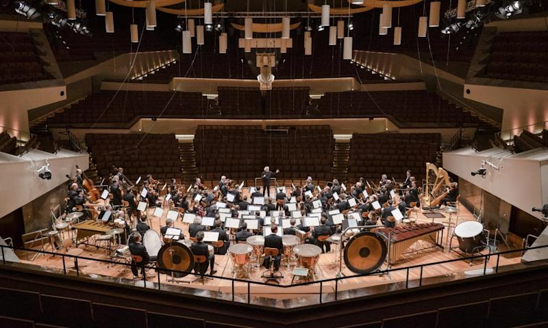The Berlin Philharmonic with conductor Simon Rattle perform without an audience at the Philharmonic Hall in Berlin, on 12 March.
