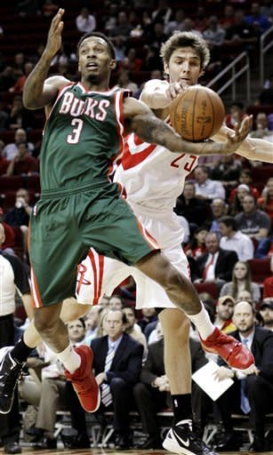 Milwaukee Bucks' Brandon Jennings (3) loses the ball on a steal by Houston Rockets' Chandler Parsons (25) in the first half of an NBA basketball game, Wednesday, Jan. 25, 2012, in Houston. (AP Photo/Pat Sullivan)
