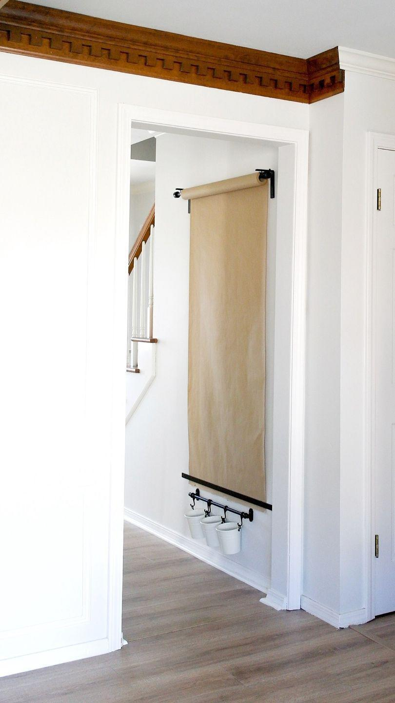 """<p>Here, your kid's habit of writing on the wall isn't a bad thing. This easel can be attached to any blank wall, doubling it as a place to put your kid's art on display or your grocery list in plain sight. </p><p><em><a href=""""https://arinsolangeathome.com/diy-wall-mounted-easel/"""" rel=""""nofollow noopener"""" target=""""_blank"""" data-ylk=""""slk:Get the tutorial at Arin Solange at Home »"""" class=""""link rapid-noclick-resp"""">Get the tutorial at Arin Solange at Home »</a></em></p>"""