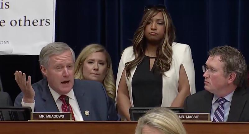 Rep. Mark Meadows R-N.C. speaks to Michael Cohen during a House Oversight Committee hearing as Lynne Patton stands behind him