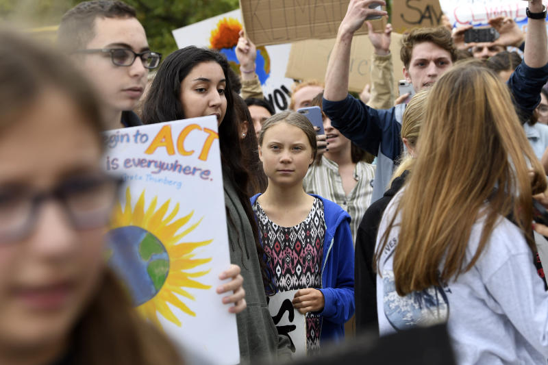 Swedish youth climate activist Greta Thunberg, center, marches with other young climate activists for a climate strike outside the White House in Washington, Friday, Sept. 13, 2019. (AP Photo/Susan Walsh)