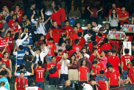 Security guards wave to urge Hong Kong fans stop booing and turning their backs during Chinese national anthem, at the Asian Cup preliminary match between Hong Kong and Lebanon in Hong Kong, China November 14, 2017. REUTERS/Bobby Yip