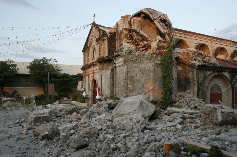 Damaged St. Catherine church is seen following a 6.1 magnitude earthquake that also caused the collapse of a commercial building in Porac township, Pampanga province, north of Manila, Philippines, Tuesday, April 23, 2019. The strong earthquake struck the northern Philippines Monday trapping some people in a collapsed building, damaged an airport terminal and knocked out power in at least one province, officials said. (AP Photo/Bullit Marquez)