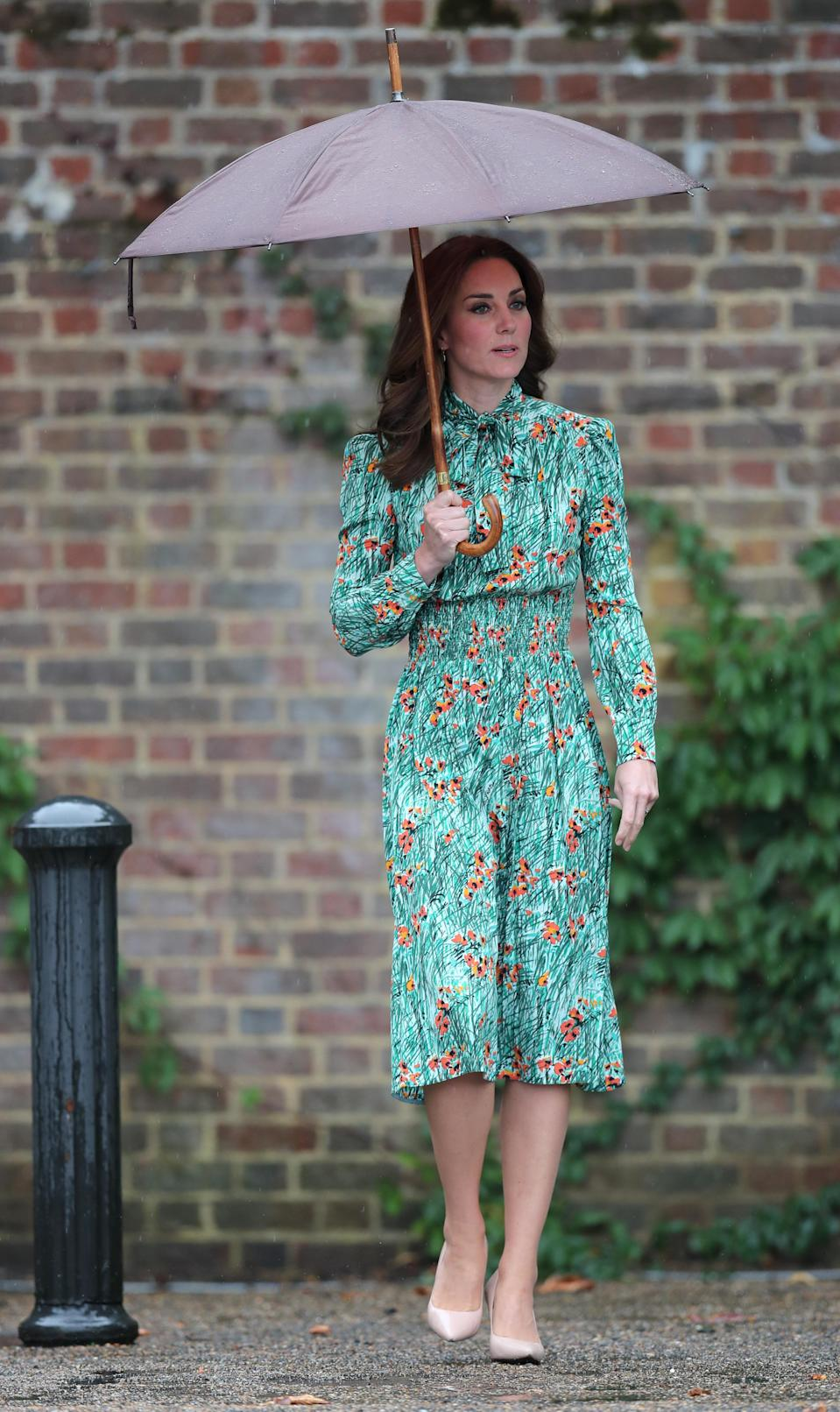 <p>The Duchess paid tribute to the late Princess Diana in a floral green Prada dress. Costing £1,420, the midi dress was worn to Kensington Palace's famous White Garden.<br><i>[Photo: PA]</i> </p>
