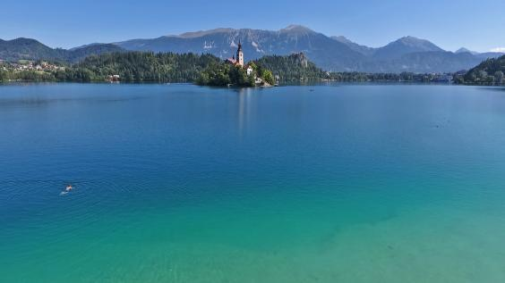 Participants swim in some of Slovenia's most beautiful lakes