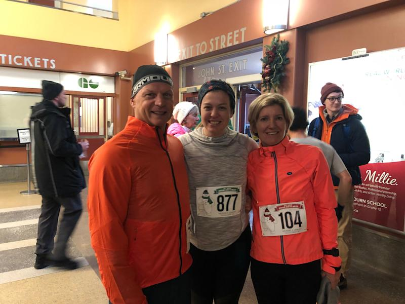 Me and my parents at a Hamilton road race in 2019. It took me years to find running enjoyable again.  (Photo: Samantha Beattie/HuffPost Canada)