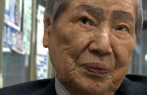 Sunao Tsuboi, who was 20 when he suffered terrible radiation burns in the atomic bombing of Hiroshima at the end of World War II, speaks in his office in the western Japanese city on March 25, 2011. The scars that still mark Tsuboi's face are a grim reminder of the power of the atom as a wave of nuclear wariness sweeps post-Fukushima Japan