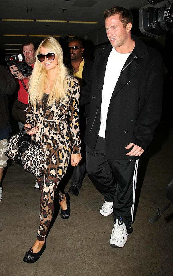 "Paris Hilton is far from ferocious in her garish cheetah-print getup. Her man's track-pants look is also a major faux pas. <a href=""http://www.splashnewsonline.com"" target=""new"">Splash News</a> - October 9, 2009"
