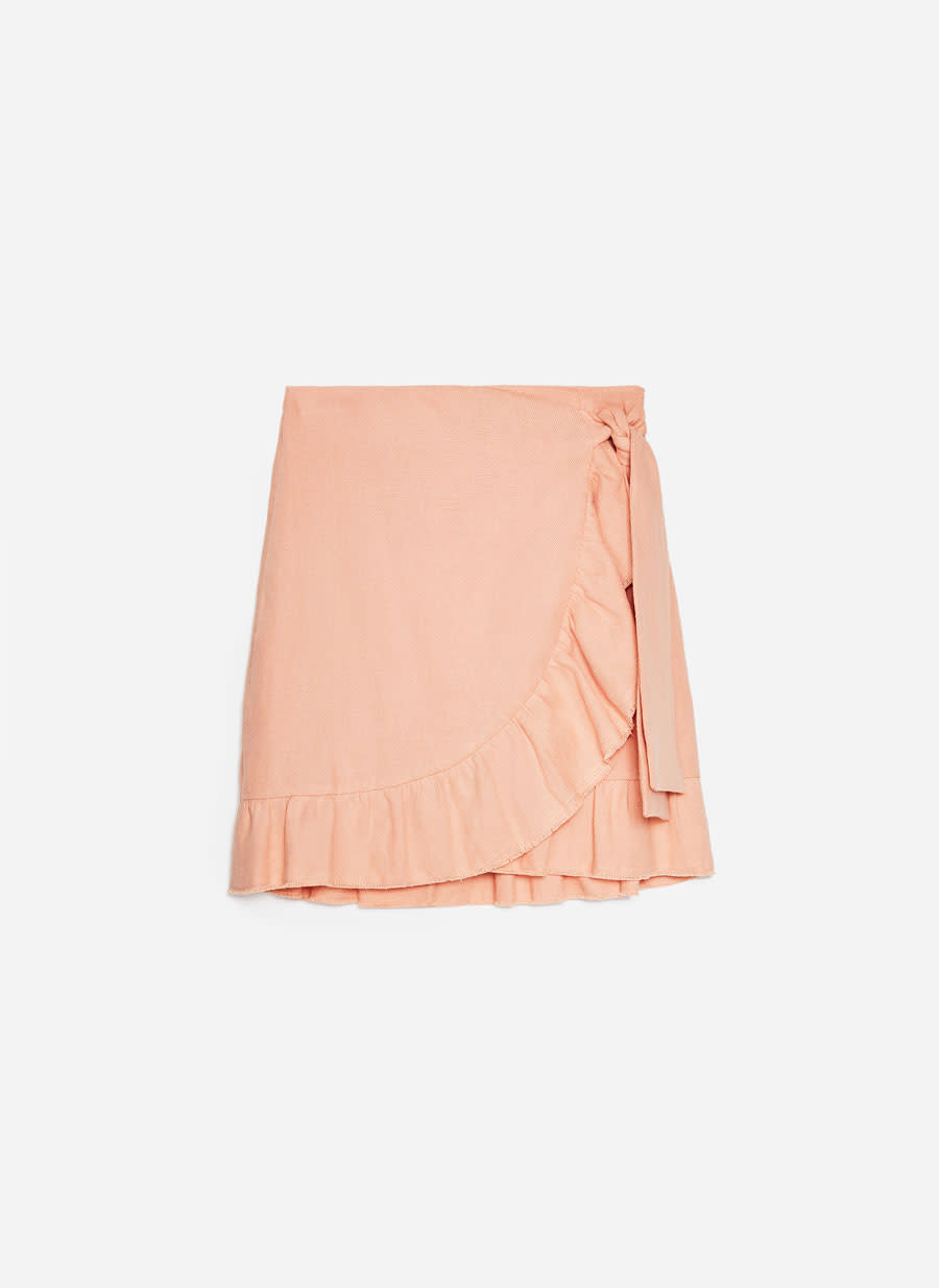 "<p>Ruffles are still in, so edgy your way into the trend with this ruddle-edge mini skirt.<br><a href=""https://www.uterque.com/gb/ready-to-wear/view-all-c1748467p8240502.html"" rel=""nofollow noopener"" target=""_blank"" data-ylk=""slk:Buy here."" class=""link rapid-noclick-resp""><em>Buy here.</em></a> </p>"