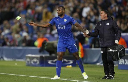 Leicester City's Wes Morgan goes off injured