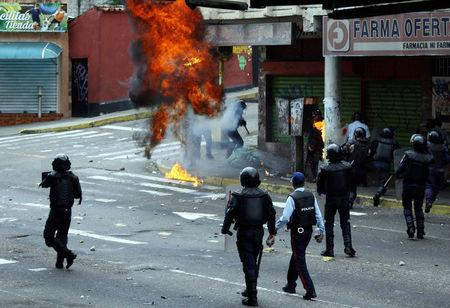 Opposition supporters clash with police during protests against unpopular leftist President Nicolas Maduro in San Cristobal