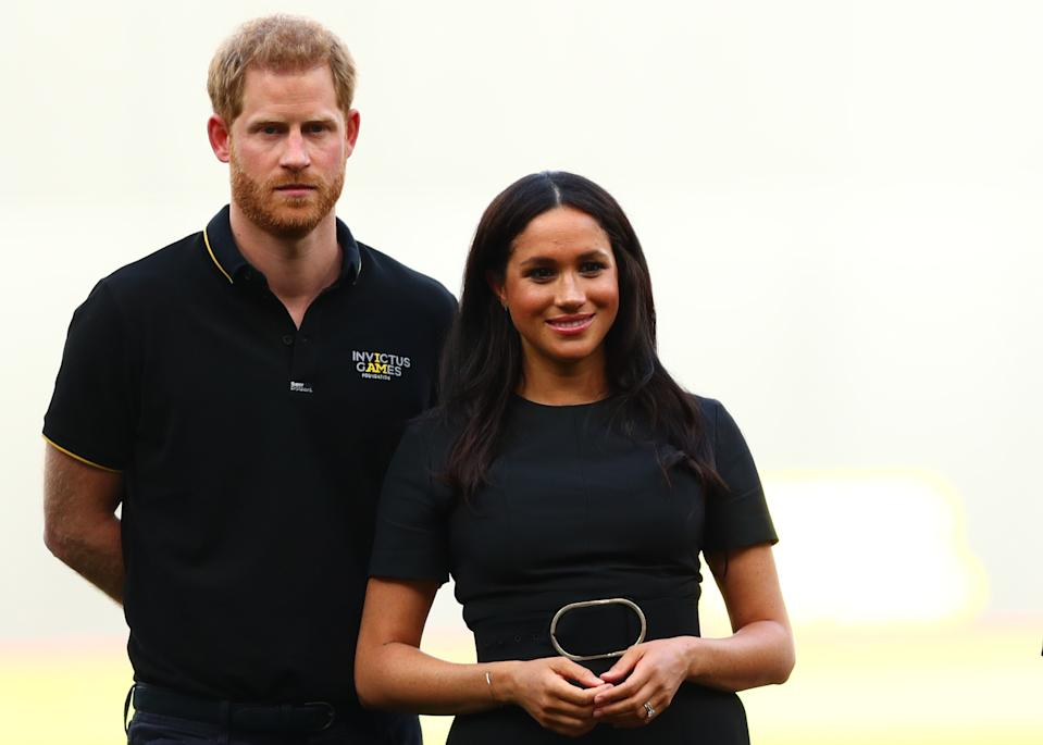 LONDON, ENGLAND - JUNE 29:  Prince Harry, Duke of Sussex and Meghan, Duchess of Sussex look on during the pre-game ceremonies before the MLB London Series game between Boston Red Sox and New York Yankees at London Stadium on June 29, 2019 in London, England. (Photo by Dan Istitene - Pool/Getty Images)