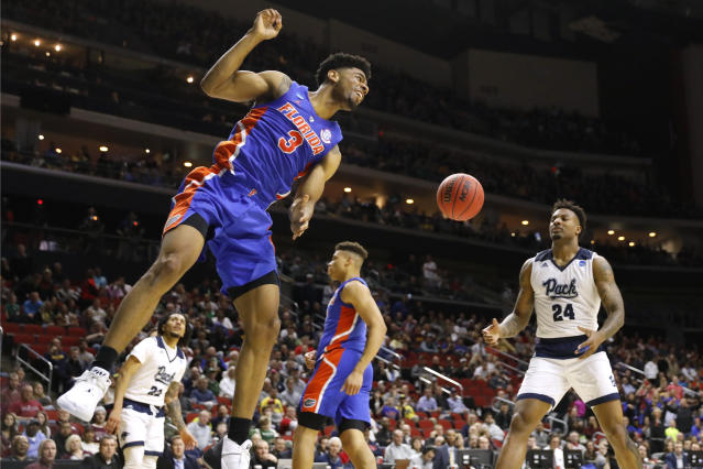Florida guard Jalen Hudson (3) reacts after dunking the ball ahead of Nevada forward Jordan Caroline (24) during a first round men's college basketball game in the NCAA Tournament, Thursday, March 21, 2019, in Des Moines, Iowa. (AP Photo/Charlie Neibergall)