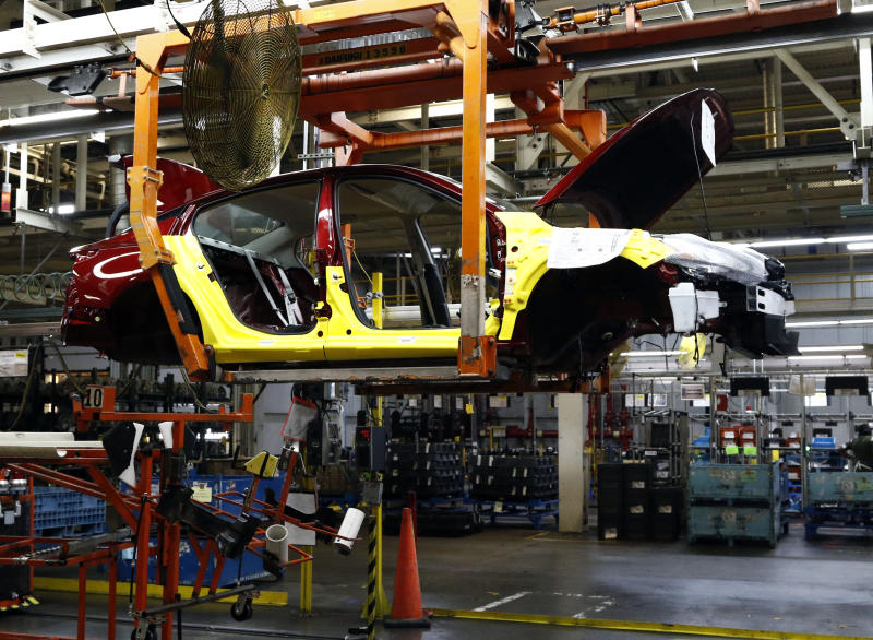 A 2019 Nissan Altima sedan is suspended on a conveyer belt at the Nissan Canton Vehicle Assembly Plant in Canton, Miss. Thursday, Sept. 27, 2018. Local and state officials joined Nissan management in unveiling the redesigned vehicle. (AP Photo/Rogelio V. Solis)