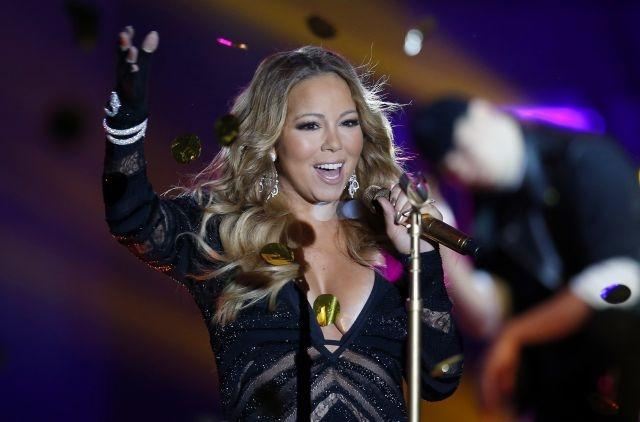 Mariah Carey first to score #1 hit in four different decades