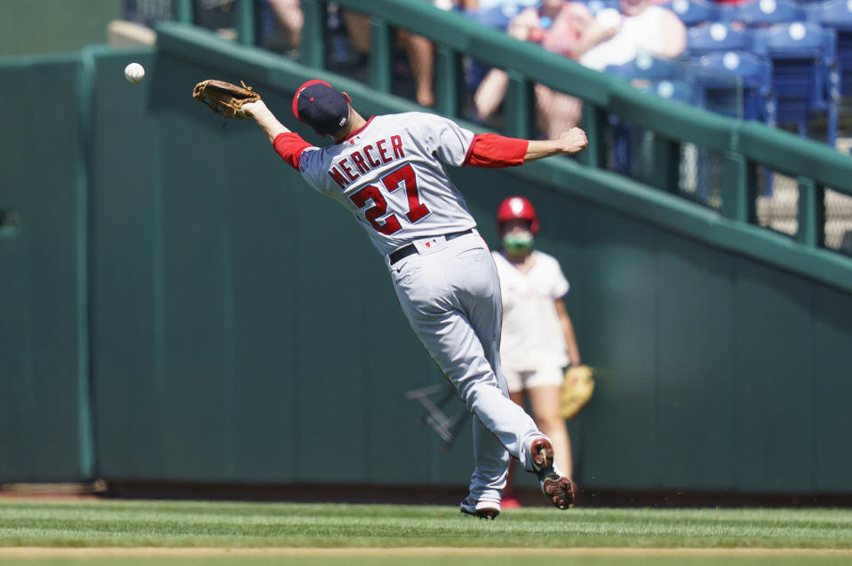 Washington Nationals second baseman Jordy Mercer is unable to catch a hit by Philadelphia Phillies' Rhys Hoskins during the fourth inning of a baseball game, Sunday, June 6, 2021, in Philadelphia. (AP Photo/Chris Szagola)