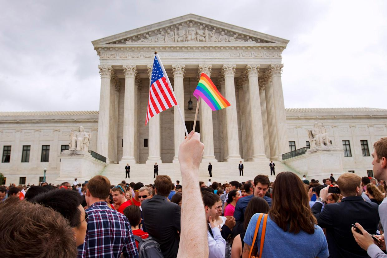 Gay rights advocates celebrated outside the Supreme Court in 2015 after the justices legalized same-sex marriage nationwide. On Tuesday, they will address LGBTQ employment discrimination.
