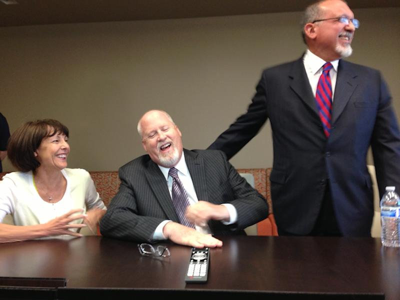 Harvey Whittemore, with his wife, Annette, on his right, jokes with his lead defense attorney, Dominic Gentile, during a news conference in Reno, Nev., on Wednesday, May 29, 2013, shortly after he was convicted of three federal counts of breaking campaign contribution laws by funneling nearly $150,000 to U.S. Sen. Reid, D-Nev., in 2007. (AP Photo/Scott Sonner)