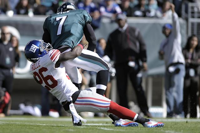 New York Giants strong safety Antrel Rolle (26) sacks Philadelphia Eagles quarterback Michael Vick (7) during the first half of an NFL football game on Sunday, Oct. 27, 2013, in Philadelphia. (AP Photo/Michael Perez)