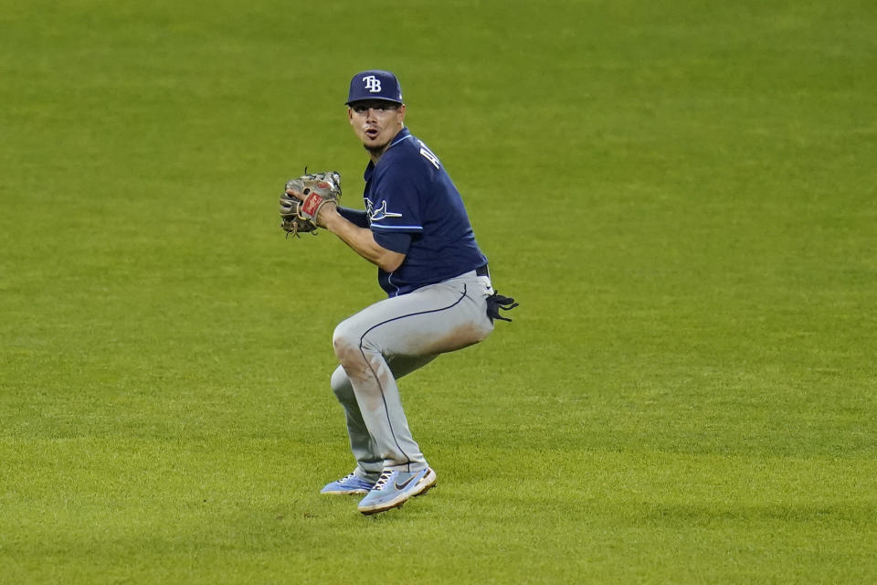Tampa Bay Rays shortstop Willy Adames fields a ground ball by Baltimore Orioles' Maikel Franco before forcing out Pedro Severino at second base to end a baseball game, Wednesday, May 19, 2021, in Baltimore. The Rays won 9-7. (AP Photo/Julio Cortez)
