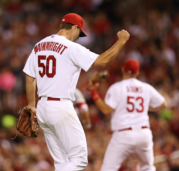 St. Louis Cardinals starting pitcher Adam Wainwright pumps his fist after inducing a double play with runners at the corners to escape the fourth inning during a baseball game against the Washington Nationals on Monday, Sept. 23, 2013, in St. Louis. The Cardinals won 4-3. (AP Photo/St. Louis Post-Dispatch, Chris Lee) EDWARDSVILLE OUT ALTON OUT