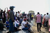 Protesters block the train tracks on the railway line between Yangon and the southern city of Mawlamyine