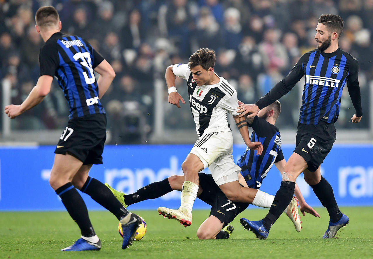 Juventus' Paulo Dybala is challenged by Inter's Roberto Gagliardini, right, during the Serie A soccer match between Juventus and Inter Milan at the Turin Allianz stadium, Italy, Friday, Dec. 7, 2018. (Alessandro Di Marco/ANSA via AP)