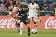 Philadelphia Union midfielder Leon Flach, right, battles for the ball against Toronto FC midfielder Jonathan Osorio, left, during the first half of an MLS soccer match, Wednesday, Aug. 4, 2021, in Chester, Pa. (AP Photo/Christopher Szagola)